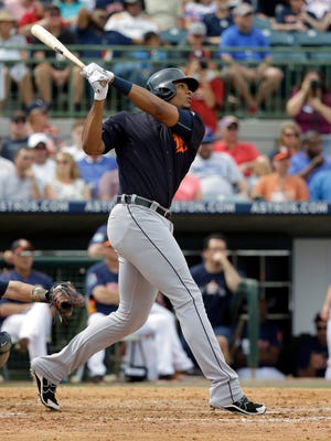 The Detroit Tigers' Steven Moya hits a home run against the Houston Astros in the fourth inning Friday, March 11, 2016, in Kissimmee, Fla.