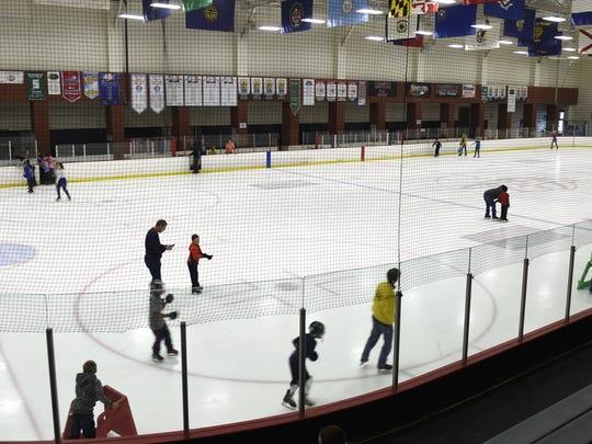 Ice skaters enjoy an open skate at Centennial Sportsplex.