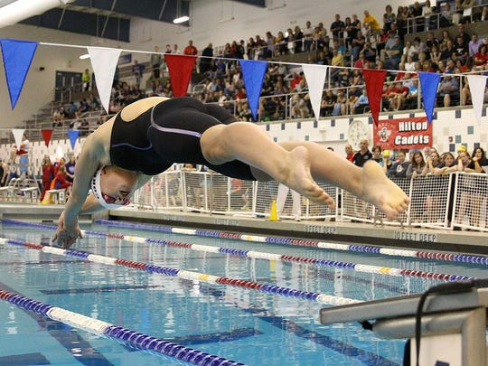 Pittsford's Emma Corby off the blocks ti win the 100 Butterfly.