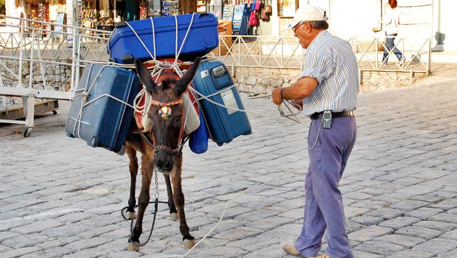 Since there are no cars on the Greek island of Hydra, you need to pack light or hire a donkey.