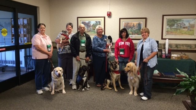 The Great Lakes K-9 Therapy Dog Club entertained residents of Marwood Nursing and Rehab with a dog parade on Sept. 13. Pictured from left: Carolyn Crowe with Toby, Port Huron; Anna Deni with Sissy, Port Huron; Al Kasdorf with Izzy, Fort Gratiot; Sandy Hunwick with Jake, Fort Gratiot; Lisa Richardson with Bear, Marysville; and Cathie DeLand with Wyatt, Port Huron.