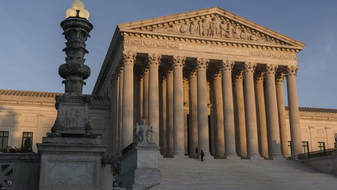 The Supreme Court is seen as sundown in Washington, Friday, Nov. 6, 2020.