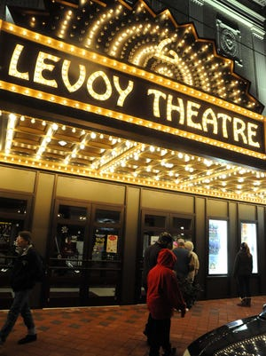 The Levoy Theatre lights up High Street in Millville.