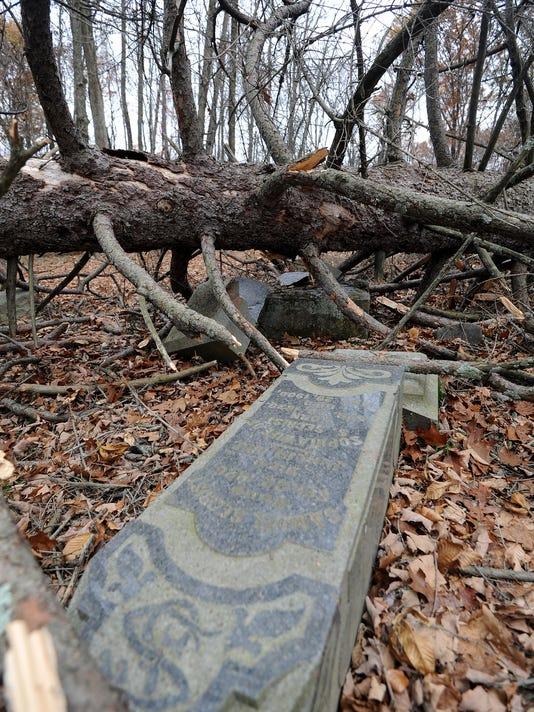 grave markers damaged 01.jpg