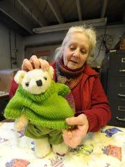 Martha Gray of Bellville dresses a teddy bear in handmade custom clothing on March 9 at Malabar Farm.