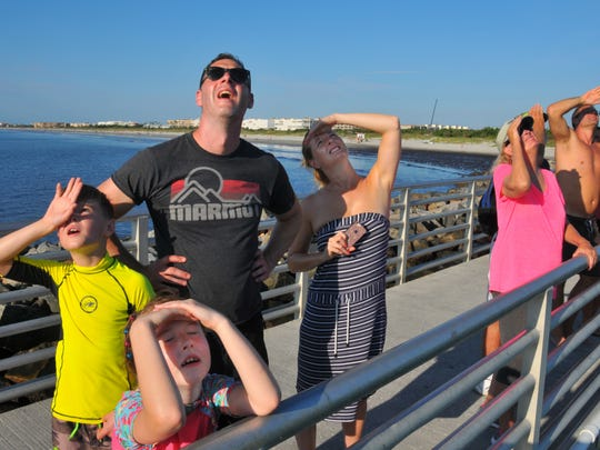 The Wright family - John and Jo with their children Will and Eva- on holiday from England  wach the launch. Crowds lined the jetties at Jetty park in Port Canaveral to watch the launch of a United Launch Alliance Atlas V rocket carrying NASA's newest communications satellite, known as TDRS-M. The rocket launched from Cape Canaveral Air Force Station at 8.:29 a.m.