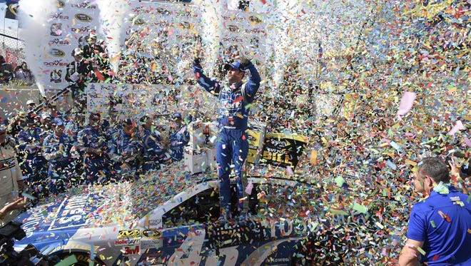 Jimmie Johnson celebrates in Victory Lane after he won the NASCAR Sprint Cup series auto race at Dover International Speedway on Sunday.