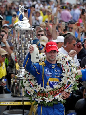 Alexander Rossi celebrates after winning the 100th running of the Indianapolis 500 auto race at Indianapolis Motor Speedway in Indianapolis, Sunday, May 29, 2016.
