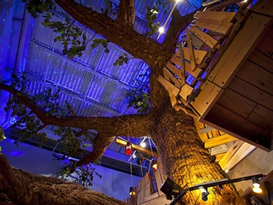 Georgie Porgie's Treefort Restaurant in Oak Creek boasts Hershey Syrup can lights, tables with old-fashioned toys inside them, outhouse-style restrooms, a go-kart hanging from the wall and a tree in the middle of the restaurant.