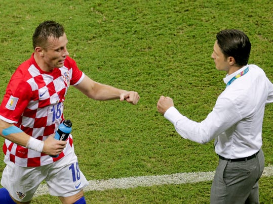 Croatia's Ivica Olic, left, is congratulated by Croatia's coach Niko Kovac after scoring the opening goal during the group A World Cup soccer match between Cameroon and Croatia at the Arena da Amazonia in Manaus, Brazil, Wednesday, June 18, 2014. (AP Photo/Fernando Llano)