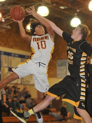 Tulare Union's Kazmir Allen attempts to shoot against