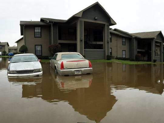 Nantucket Harbor apartments near Caddo Lake has flooding in the parking lot affecting serval cars.