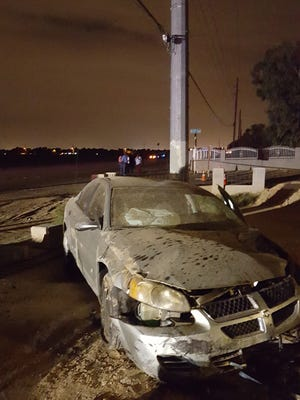 A car struck and critically injured a cyclist, then swerved into a retaining wall in west Phoenix Tuesday.