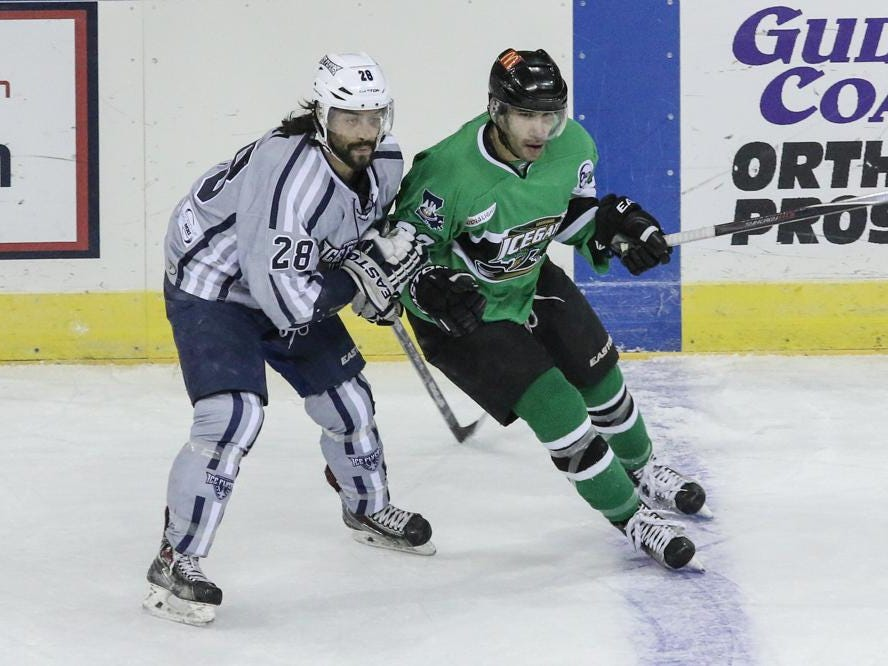 David Segal, left, of the Ice Flyers, goes up against Darius Cole of the IceGators during Friday night's game at the Pensacola Bay Center.