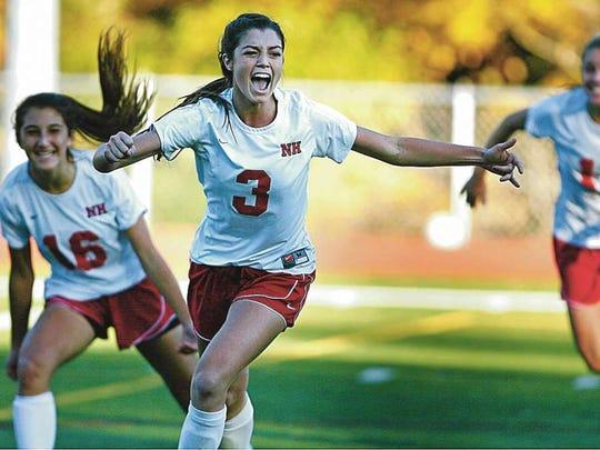 Madison Holleran (3) celebrates after scoring a goal