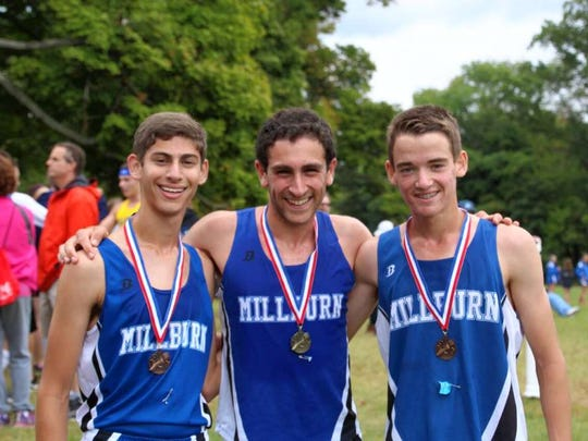 Noah Yadgaroff, Matt Grossman and Ramsey Little, from left, of Millburn High School's varsity boys cross country team sport the medals they won Sept. 24 in the Stewart Memorial Invitational Varsity A race at Greystone Park in Morris Plains.