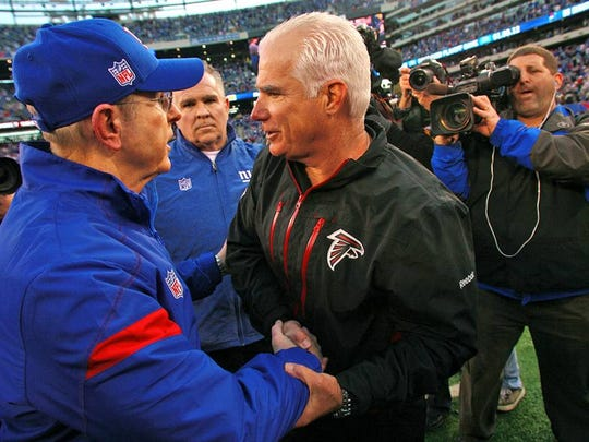 Former Atlanta Falcons head coach Mike Smith, right, is seen here with former New York Giants head coach Tom Coughlin in a file photo. Smith is considered a candidate to replace Ben McAdoo with the Giants.