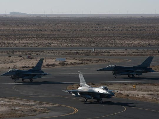 F-16 Fighting Falcons assigned to the 134th Expeditionary Fighter Squadron taxi onto the ramp at the 407th Air Expeditionary Group, Southwest Asia, on Saturday. The F-16 squadron is comprised of airmen from the 158th Fighter Wing of the Vermont Air National Guard.