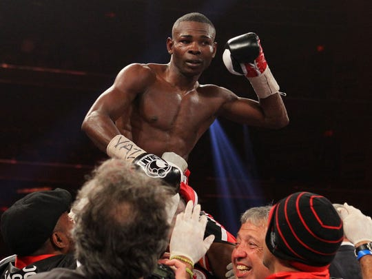 Apr 13, 2013; New York, NY, USA; Guillermo Rigondeaux celebrates his 12-round unanimous decision win over Nonito Donaire (not shown) at Radio City Music Hall. Mandatory Credit: Ed Mulholland-USA TODAY Sports ORG XMIT: USATSI-130794 ORIG FILE ID: 20130413_tjg_se8_865.JPG