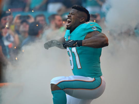 Dec 3, 2017; Miami Gardens, FL, USA; Miami Dolphins defensive end Cameron Wake (91) reacts during player introduction before the game against the Denver Broncos at Hard Rock Stadium. Mandatory Credit: Jasen Vinlove-USA TODAY Sports