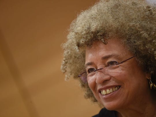 """US political civil-rights activist Angela Davis attends a meeting """"The meaning of white supremacy today"""", held at """"Roma TRE University"""" , on March 14, 2016 in Rome.  / AFP PHOTO / ANDREAS SOLAROANDREAS SOLARO/AFP/Getty Images ORG XMIT: 107 ORIG FILE ID: 550011528"""