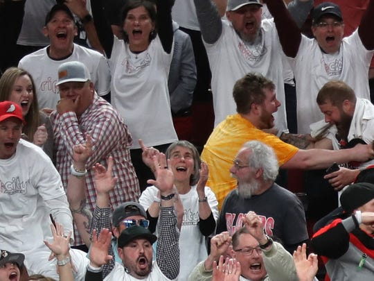 Damian Lillard celebrates his game winning shot April 23 -- with announcer Brian Anderson in the background calling the action.