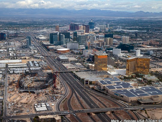 May 23, 2019; Las Vegas, NV, USA; Aerial view of construction underway of the Las Vegas Stadium (bottom left) near the Las Vegas Strip which will be the 2020 home of the Las Vegas Raiders football team. Mandatory Credit: Mark J. Rebilas-USA TODAY Sports