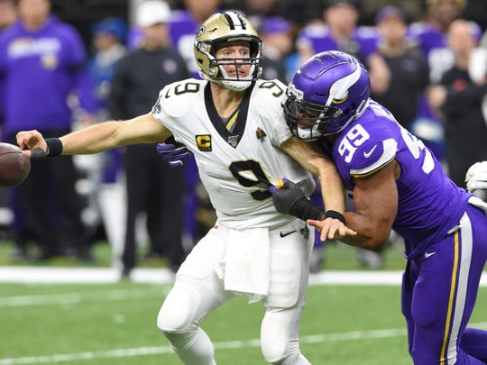 New Orleans quarterback Drew Brees (9) fumbles the ball as he is hit by Minnesota Vikings defensive end Danielle Hunter, an LSU product, during Sunday's Wildcard playoff game.