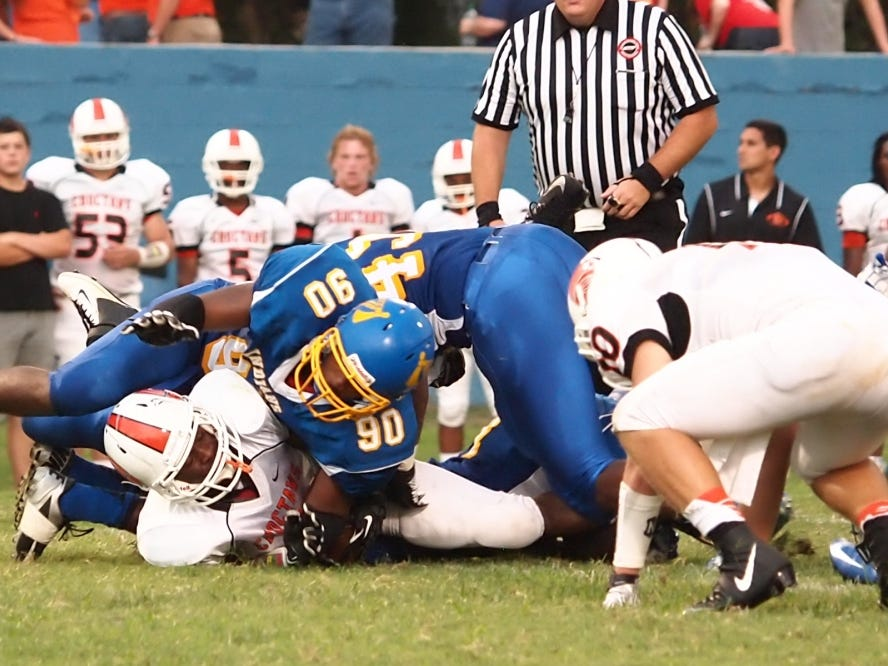 North Side's D.J. Gunn makes the tackle against Dyer County during last year's Week 0 matchup.