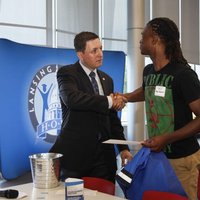Justin Sheehan, executive director of Lansing Promise, made a point to greet all incoming new students, including Mac'Quinn Norris, a recent Everett graduate and Lansing Promise scholarship recipient August 17, 2016,  during a dinner and party at the Gannon Building.  LCC is making a big effort to slow or freeze summer melt - the term for teens  who plan to go to college in the fall but slip away during the summer.  About 25 new students attended the event where student resource groups and academic advisers were on hand to answer questions.