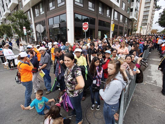 Lines to get into the 4 p.m. Mass with Pope Francis stretch down the street.