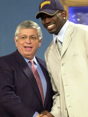 NBA Commissioner David Stern, left, congratulates Michigan State's Jason Richardson after being chosen as the fifth draft pick in the first round by the Golden State Warriors during the 2001 NBA Draft. Richardson played 14 seasons in the NBA.