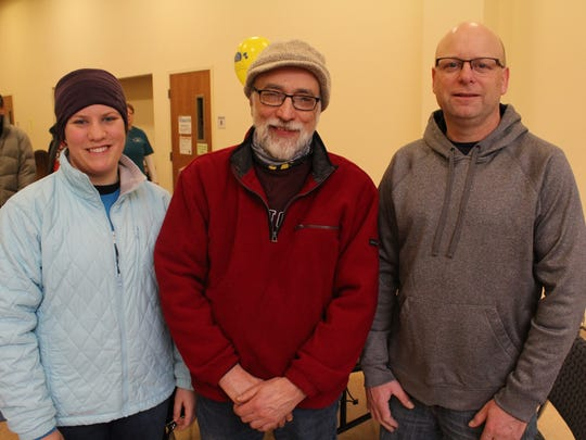 Laura Dickman, from left, Allan Dickman and Dan Maciejewski, were three of ten people who created the large interactive snow slide at this year's Souper Snow Sculpture Spectacular in Wisconsin Rapids.