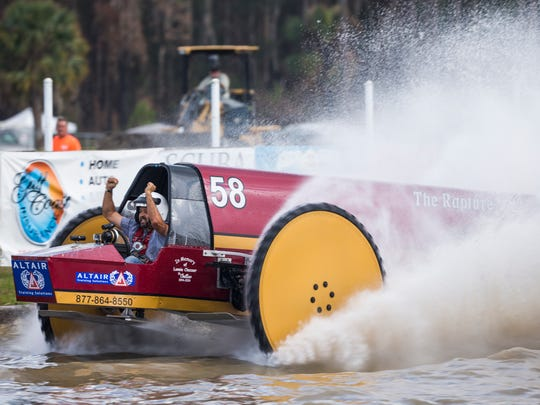 Eddie Chesser crosses the finish line in The Rapture, winning the race during the Swamp Buggy Races on Saturday, March 25, 2017 at Florida Sports Park in East Naples.