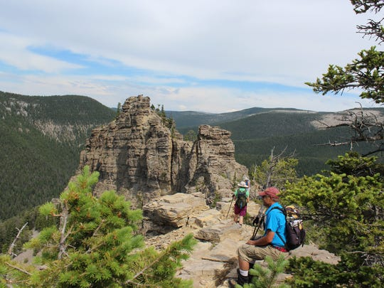 Hikers take a break and enjoy the views from Grandview Point on July 2, 2017.