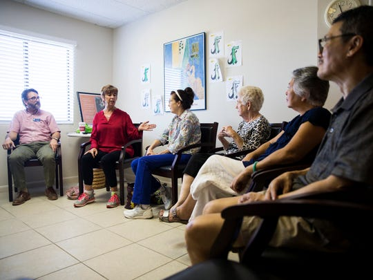 Margot Escott, a licensed therapist, second from left, leads an improvisational theater games class for people with ParkinsonÕs and caregivers in Naples on Tuesday, Nov. 7, 2017. Research from the Neurology Department of Northwestern University, partnered with Second City, shows that improvisational theatre games help to cultivate focus, improve communication, and promote well-being.