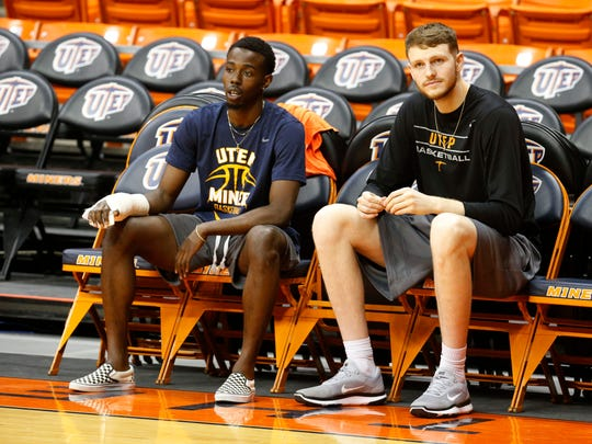 UTEP center Matt Wilms (r) sits on the sidelines and