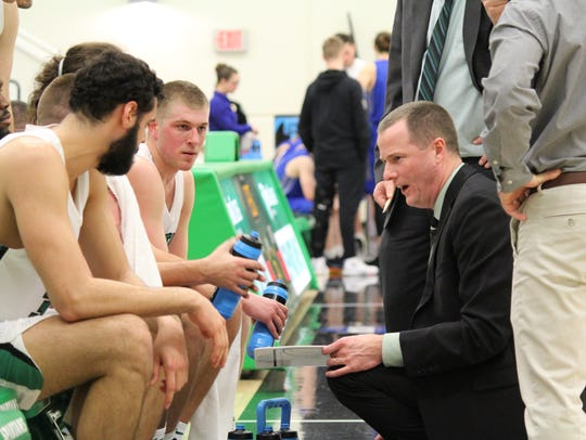 York College head coach Matt Hunter talks to his team