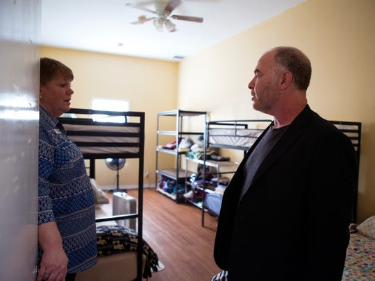 Frances Wilson (left), President and CEO of The Purple Door, gives a tour of the shelter to Dr. Jackson Katz, an educator, author, filmmaker and cultural theorist known for activism on issues of gender, race and violence, on Monday, June 25, 2018. Katz is the guest speaker for the organization's annual Great Expectations luncheon.