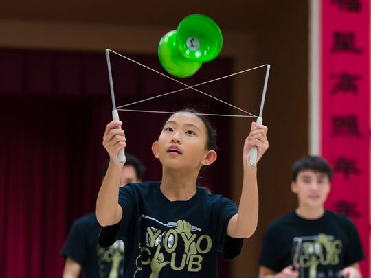 Anna Jiang, 11, practices Chinese yo-yo at a preview of the Chinese Festival at the Chinese American Community Center in Hockessin on Thursday.