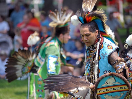 Native American dancers perform in Yoctangee Park during the 2012 Feast of the Flowering Moon.