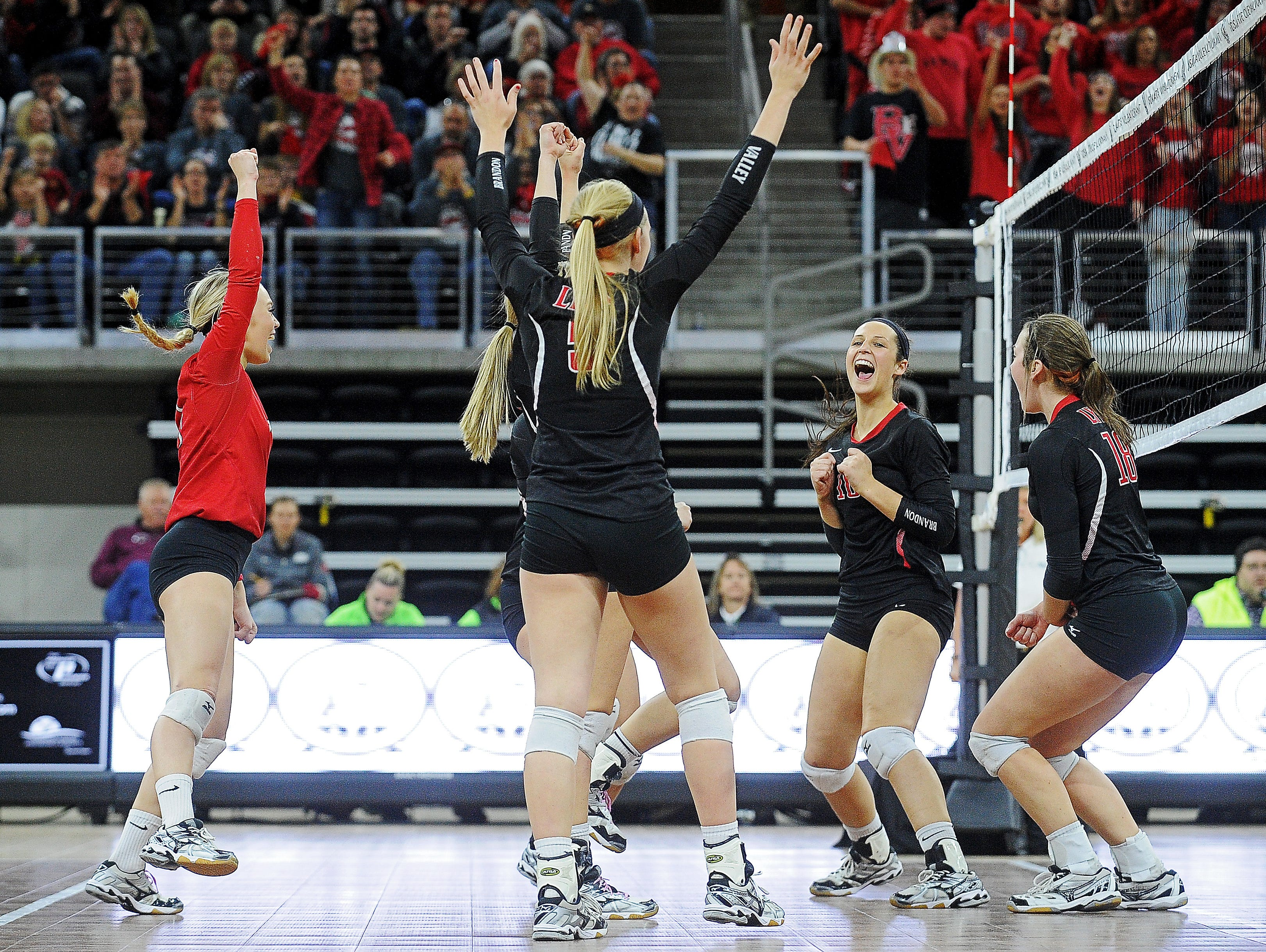 Brandon Valley players react after scoring during the South Dakota State High School Class AA championship volleyball match against Aberdeen Central Saturday, Nov. 21, 2015, at the Denny Sanford Premier Center in Sioux Falls.