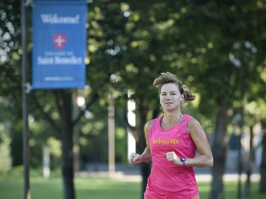 Robin Balder-Lanoue starts her morning run Friday at the College of St. Benedict in St. Joseph.