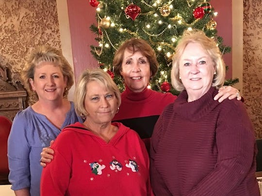 """Members of Xi Epsilon Beta, a chapter of Beta Sigma Phi, attend the """"White Christmas"""" at the Paramount Theater on Dec. 9. From left: Donna Littlefield, Barbara Brown, Andrea Mulheron and Jennifer Green."""
