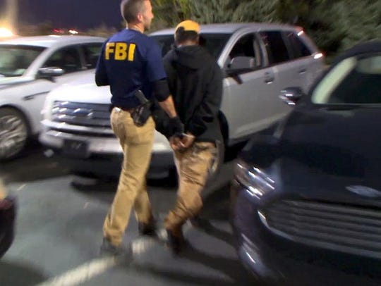 In Detroit, an FBI agent takes a suspected pimp into