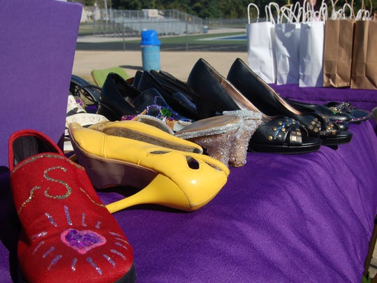 In this Bulletin File Photo, women's shoes are shown at a previous Walk a Mile in Her Shoes event benefiting Serenity, Inc.