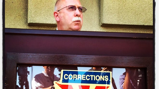 Arizona Department of Correction Director Charles Ryan, in foreground, talks about review of the execution of James Wood in Phoenix, on Thursday July 24, 2014.