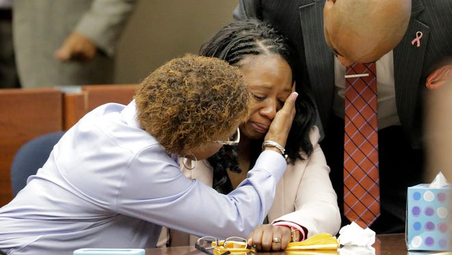 Wakesha Ives, 39, center, is comforted by her husband, right, and former pastor, left, during a break while waiting to be sentenced after more than 20 character witnesses gave statements on her behalf. After the 15 minute break, Ives was sentenced to a six-month suspended jail sentence and two years of probation by 384th District Judge Patrick Garcia. Ives was found guilty by a jury Sept. 19 in connection with the death of her daughter, Janay Aliah Ives.