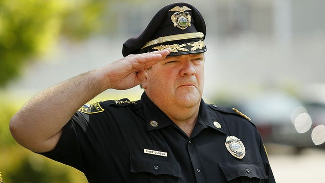 Former Hingham Police Chief Glenn Olsson did nothing wrong when he walked into the regional dispatch center and had a log entry changed, according to a private investigation report.He salutes during a ceremony for Peace Officers Memorial Day at the Hingham Police Station on  Tuesday, May 15, 2018, Greg Derr/ The Patriot Ledger