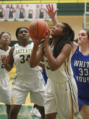 Gallatin's Makayla Wright shoots as White House's Ragan Anderson reaches for the ball on Tues. Jan. 2, 2018.